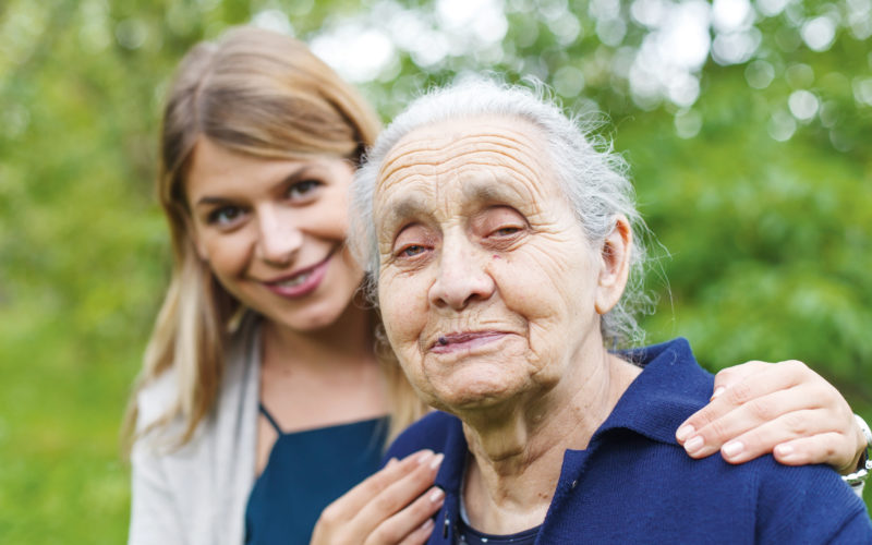 Portrait of an old woman, spending time with her granddaughter
